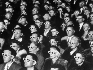 "Photo #: 259232 Date Taken:  11-26-1952 Description: 3-D Movie Viewers. Formally-attired audience sporting 3-D glasses during opening night screening of film ""Bwana Devil,"" the 1st full-length color 3-D (aka ""Natural Vision"") motion picture, at Paramount Theater. City: HOLLYWOOD State: CA Country: US Photographer: J. R. EYERMAN/TimePix"